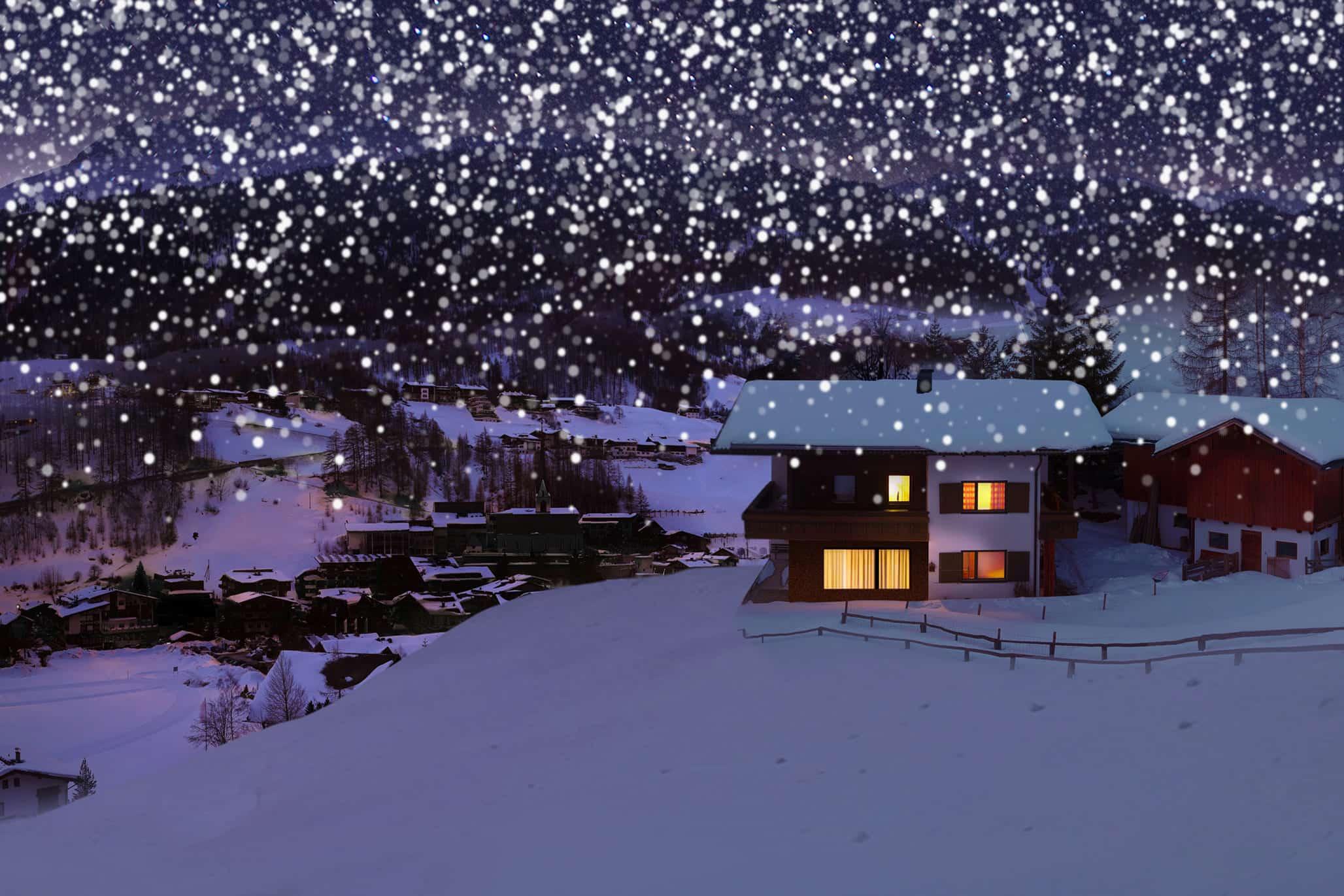 Winterliches Dorf in der Nacht